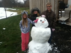 My oldest two and my niece built a snow man in my sister's back yard.